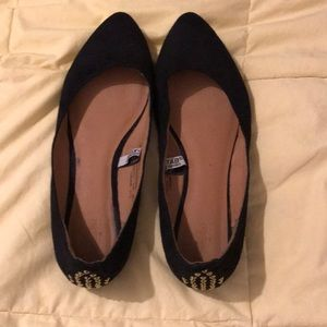 Black flats with stud detail size 8